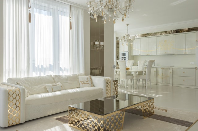 a white living room and kitchen