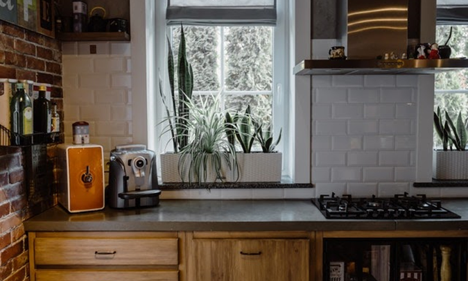a clean kitchen with wooden elements